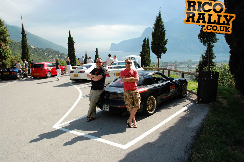 Tuure & Matti in their RX7 overlooking Lake Garda